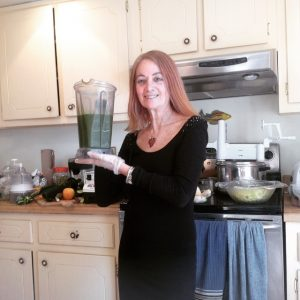 Karen holding green smoothie