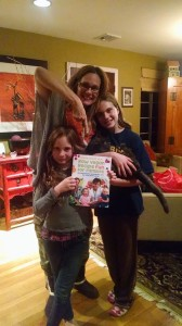 kim ferrentino and daughters with book