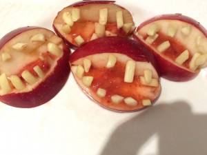 Halloween Apple Mouths with strawberry sauce