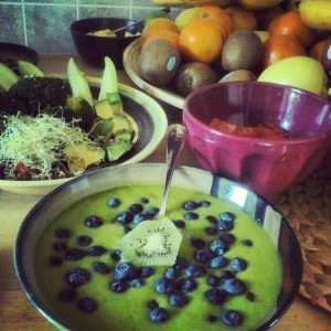 green soup with blueberries